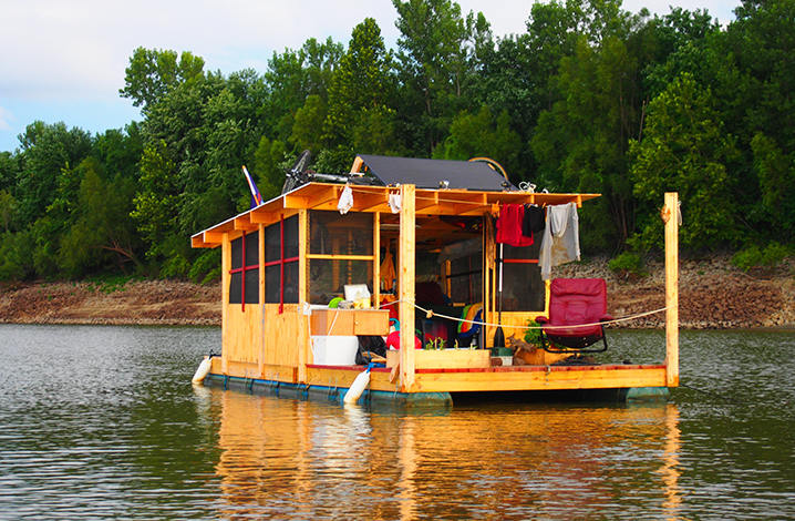 Floating House Rafts Along The River